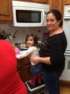 My sister, mom and niece cooking up Thanksgiving dinner.