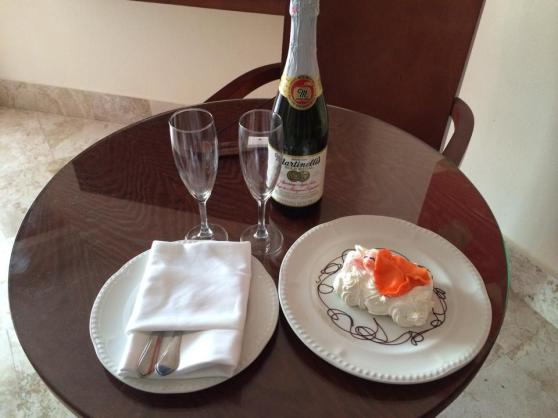 A special babymoon gift from our concierge. Sparkling cider and a freaky baby cake!