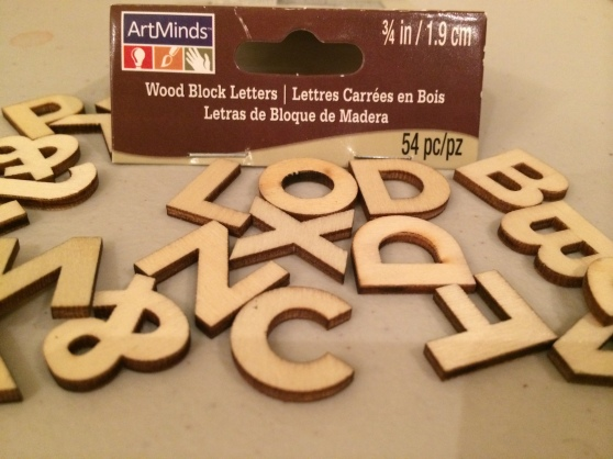 "We took these wooden letters from Michael's and spelled out ""weeks"" and ""months"" (we'll do ""years"" during our Crafting Day - Part 2) and used acrylic paint to beautify them."