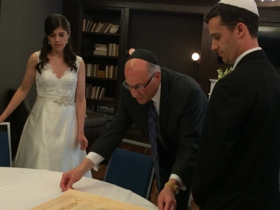 Signing the Ketubah (Jewish marriage license).