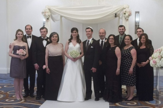The bride and groom with both families.