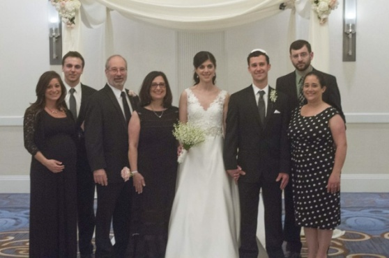 The bride and groom with our fam.