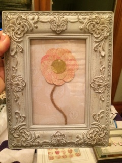 Scrapbook paper flower with a hemp stem.