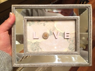 The mirror frame and bad lighting make this one hard to see. But, I just used scrapbook paper inside the frame and painted letters/a button glued on top of the glass to give this one a little dimension and added interest.