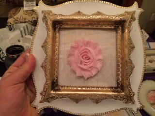 This was my last one... creativity was running thin, and I was already wounded from the hot glue gun. So, this one is just scrapbook paper inside the frame and a fabric flower glued to the outside of the glass.