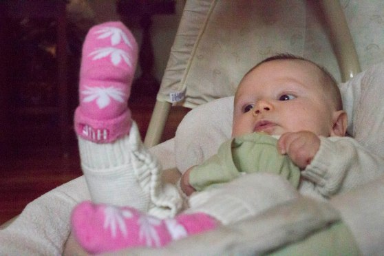 Charlotte checking out her naughty socks... another gift from my silly cousin.